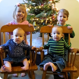 All Four Kids by Christmas Tree