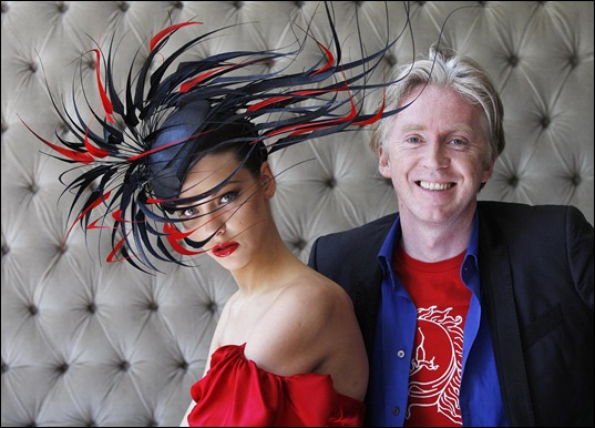 NO REPRO FEE..<br />Pictured is internationally renowned Irish designer, Philip Treacy with model Klaudia Molenda unveiling his latest creation inspired by Lyons Gold Blend tea on Tuesday 2nd June 2009 in the dylan Hotel, Dublin. The one of a kind hat was specially created to celebrate the rich qualities of Lyons Gold Blend, which new research has revealed as the best tasting gold blend tea, out performing competitors on taste, colour, flavour, appearance and mouth feel in both blind and branded research. The hat will be on display at the Lyons Gold Blend tent at Taste of Dublin 'where great taste meets great style' from 11th June 2009. One lucky person will win the bespoke Philip Treacy creation as Irish people will be able to enter a draw at the Lyons Gold Blend tent and online at www.lyonsgoldblend.ie. Photographer Robbie Reynolds. <br />