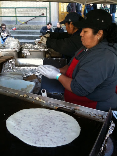 Tortillas on the grill for huaraches.