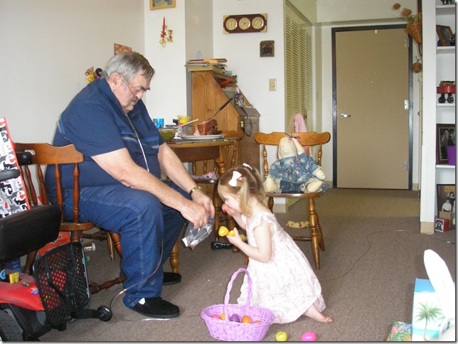Grampy and Kaitlyn (3 years old) hunting for Easter Eggs at Grammy and Grampy's