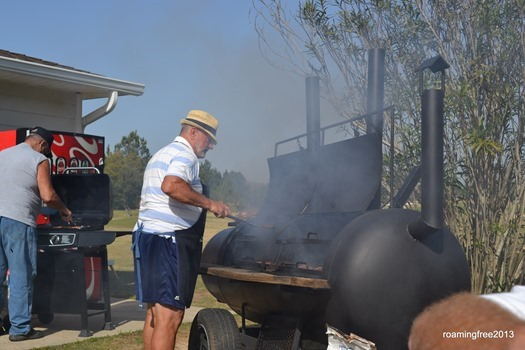 Cooking burgers at the picnic