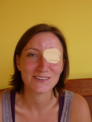 Talking like a pirate after a visit to the Ecuadorian eye doctor to remove a piece of something in her eye.