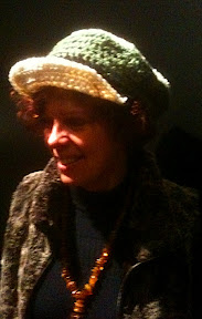 Lisa of www.sunddesignstudio@shaw.ca wearing a hat from my collection and her own original jewelery.
