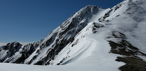 Looking back at the dramatic n.w. face of Sayres with some lingering a lingering cornice on the ridge.