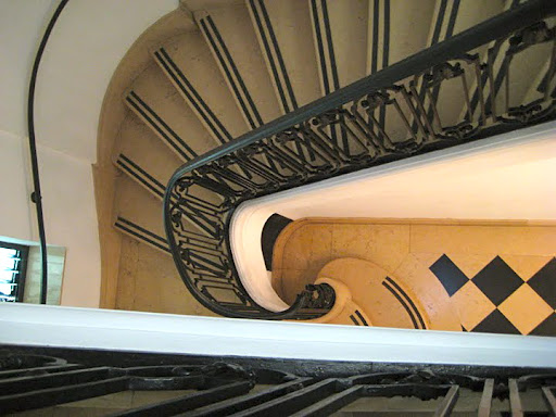 The staircase is marble and spiraling.