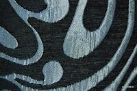 Tkanina obiciowa w stylu lat 60-tych, 70-tych. Czarna.