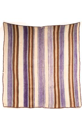 A vintage alpaca throw would be at home on a wall as a tapestry or on a decorative table. (lavivahome.com)