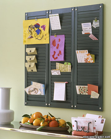 A collection of shutters mounted to the wall makes a nice organizer for papers and notes.