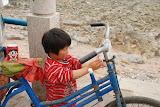 Qingdao - Enfant au vélo sur la plage