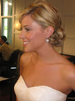 Liz wore her hair in a low, loose chignon held together with a healthy dose of hairspray. She also donned earrings by Jennifer Miller to add some sparkle. Good costume jewelry is great for traveling to destinations.