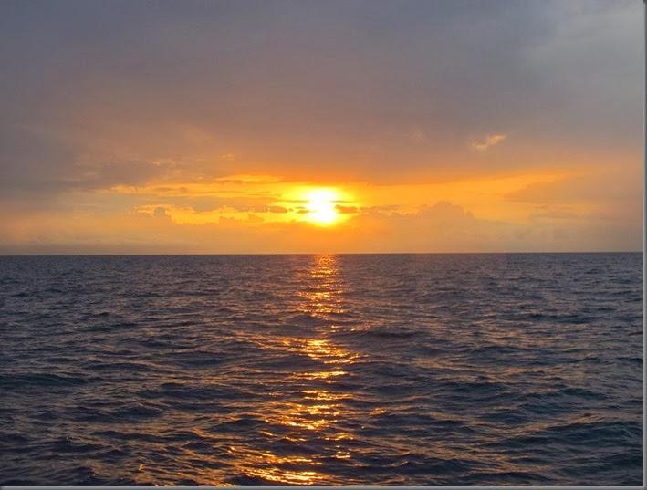 sunset open ocean circumnavigating by sailboat
