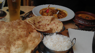 Kayal restaurant in Leicester, tucking in Bathura, Curry, Rice