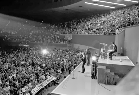 The Beatles perform at the Memorial Coliseum in Dallas, Texas, Sept. 18, 1964 on their second U.S. tour. On drums, right, is Ringo Starr.