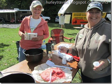 Connie and Yvette making strawberry dessert and chili in the dutch oven.