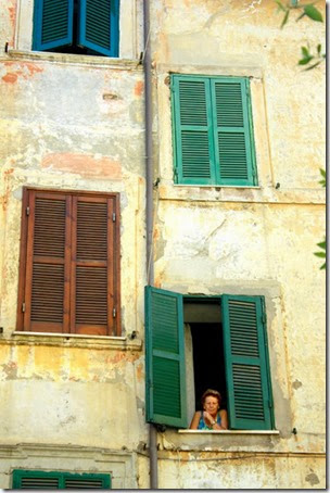 small-town-italy-watching-the-word-out-window