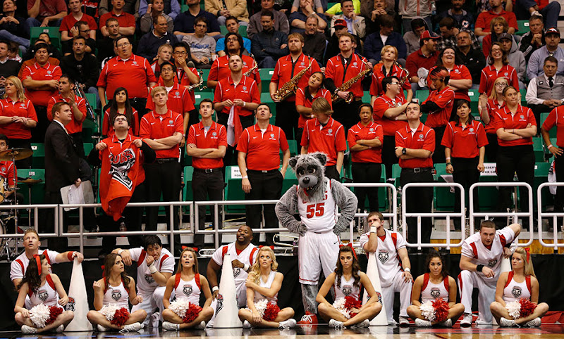 University of New Mexico cheerleaders and band react as the basketball team loses to Harvard in the NCAA tournament