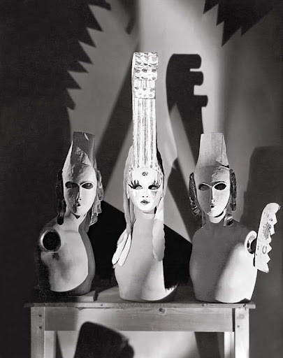 Three masks designed by Oliver Messel worn by Elsie De Wolf and her two escorts to the Flora and Fauna Ball.