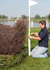Tom completes the lake Grassroots fence with the flag