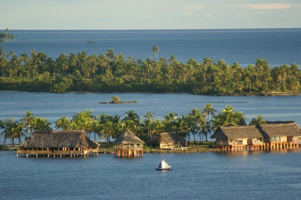 Aerial view of the Hotel Sapibenega Kuna Lodge on the island of San Blas, Panama. Rising ocean levels caused by global warming and decades of coral reef destruction have combined with seasonal rains to submerge the Caribbean islands for days on end. businesstravelerpanama.com