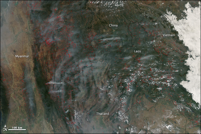 Fire and smoke dominate the landscape in this image of Southeast Asia taken by the Moderate Resolution Imaging Spectroradiometer (MODIS) on NASA's Aqua satellite on 18 March 2014. Marked in red, the fires burn largely in the subtropical forests common in northern Indochina. Most fires in this region are deliberately set for a variety of reasons, including slash and burn agriculture. Photo: Jeff Schmaltz / NASA GSFC