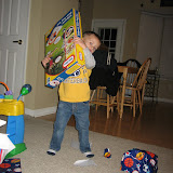 Sam opening his presents 11-3-11 (3).JPG