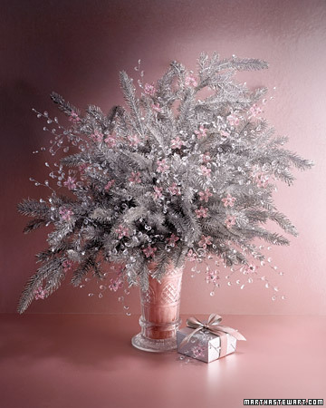 Icy dewdrops -- actually sprays of clear beads -- deliver glimmers of brightness to an arrangement of silvery faux branches.