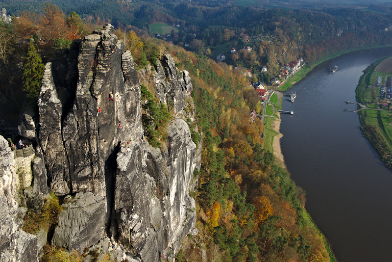Climbers enjoy the warm autumn day, in Saechsische Schweiz, Germany.