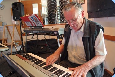 Roy Steen playing the Club's Korg SP-250 digital piano. Photo courtesy of Dennis Lyons