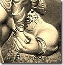 Hanuman holding Lakshmana's feet