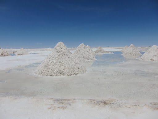 Piles of salt, drying in the sun before processing.