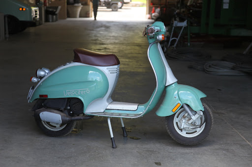 Oh wow!  It's Martha's Velocifero scooter that's usually in East Hampton.  Franny and I like to spin around the Hamptons on this thing.  It's really cool!