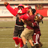 Benny the Bull and Lil&#039; Mo play keep away from a ball boy at Saturday&#039;s game.  Benny the Bull held the role of Monte a few years ago before he made the move to the Chicago Bulls and is a familiar sight either on the field or the basketball court.  Washington-Grizzly Stadium in Missoula, MT, Sept. 22nd, 2012.