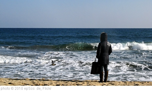 'Lonely Woman Watching Sea Waves on Beach' photo (c) 2010, epSos .de - license: http://creativecommons.org/licenses/by/2.0/