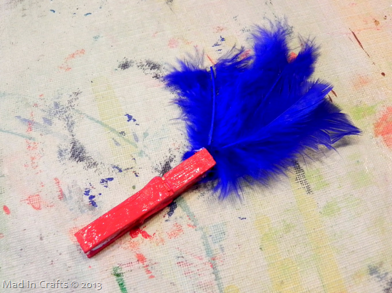 glue in blue feathers