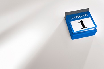 Calendar pages flipping new year