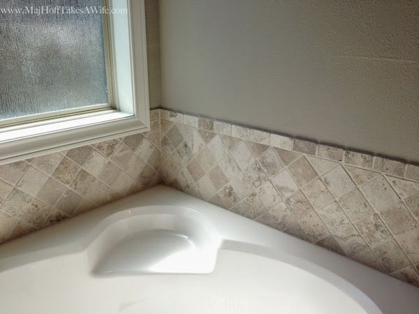 Tile surround on builder grade house in Texas
