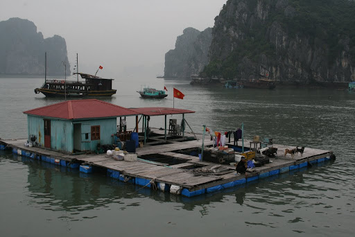 One of the fishing platforms, proudly displaying the Vietnamese flag. And the daily washing.
