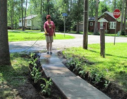 1407174 July 15 Barb Washing Mud Off Sidewalk