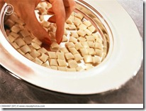 http://www.visualphotos.com/image/2x2703755/hand_taking_communion_bread