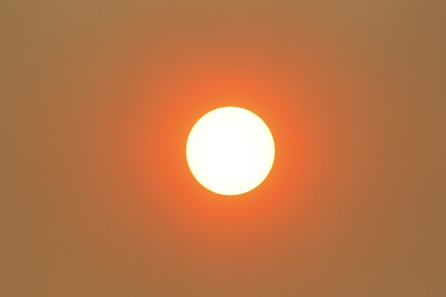 Hobart sun through bushfire smoke at around 5.30pm, 8 January 2013. Adelaide Now