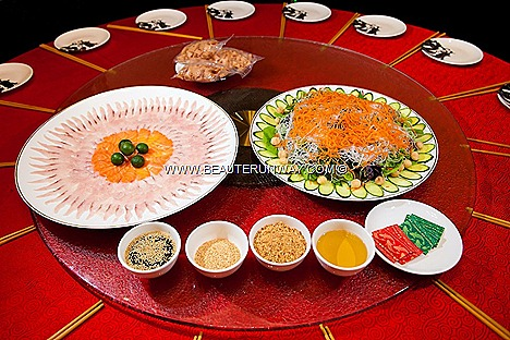 Old Hong Kong Prosperity Lo Hei Yu Sheng Healthy Appetizer  floral arrangement  Lo Hei ingredients prosperity freshly sliced raw fish and salmon salad fruits macadamia nuts gold nuggets lemon lime raw fruit juice sauce Vegetarian