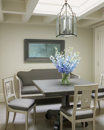 With its coffered ceiling, which conceals support beams, this room lacks the height of the rest of the apartment; the skylight, however, opens up the space.