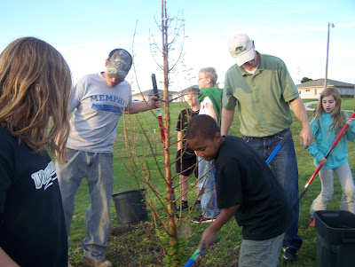 4-H Horse and Pony Club members learn how to plant trees from Dustin Hendrix, Trees Forever consultant (second from right).  Photo courtesy:  Washington County Extension.