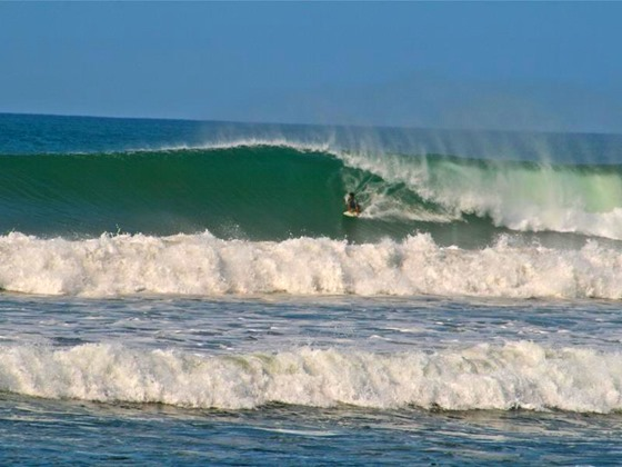 Surfer at Playa Camaronal Beach