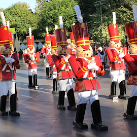 Toy Soldiers at Disneyland by Joel Ortiz - City,  Street & Park  Amusement Parks ( parade, red, marching., fun, trumpets )