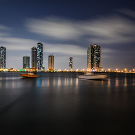 Night view at Al Khan Lagoon by S.m. Haque - Buildings & Architecture Other Exteriors ( night photography, uae, buildings, long exposure, cityscape, sharjah, nightscape )