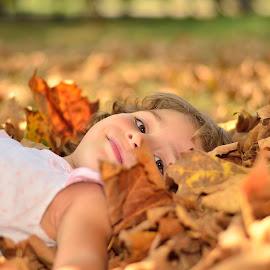 Autumn play by Sorin Dafinoiu - Babies & Children Child Portraits ( autumn, outdoor, child portrait, autumn colours, leaves, smile, portrait,  )
