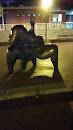 Estatua Tio Musculado