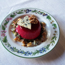 Beet Panna Cotta with Beet Greens in Vinaigrette, Gorgonzola, and Roasted Walnuts