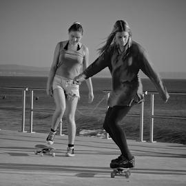 Skater Girls by Mariana Cordeiro - Sports & Fitness Skateboarding ( girls, skate, black and white, movement, street photography,  )